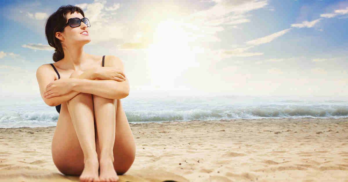 Frau beim Sonnenbaden